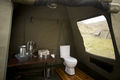 Each en suite bathroom on this camping safari to Botswana is fitted with a flush toilet